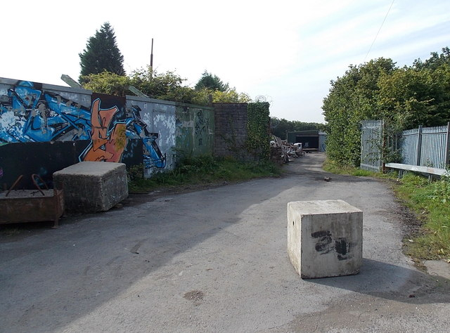 Concrete blocks at the entrance to a scrapyard in Waunarlwydd