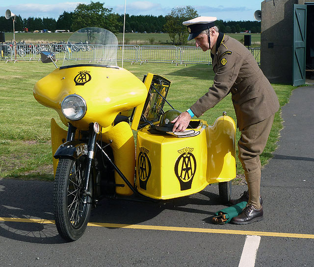 A vintage AA Patrol motorcycle and sidecar