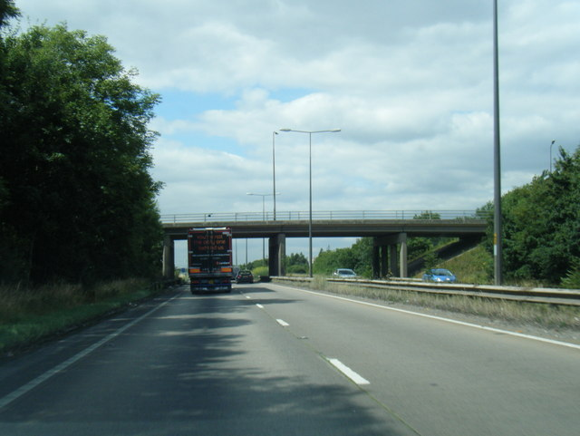 A180 westbound passes under Woad Lane