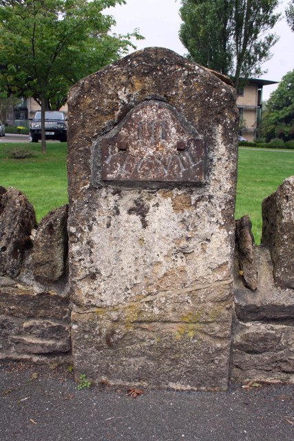 Old milestone in wall on NW side of High Street