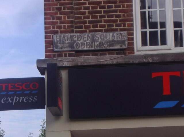Old sign for Hampden Square shop numbers