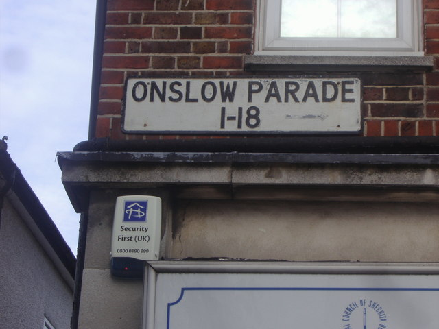 Sign for shop number directions on Onslow Parade
