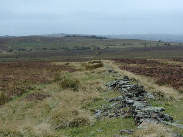 Old wall across open moorland