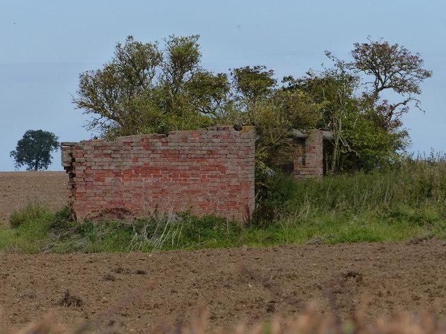 Derelict brick farm building
