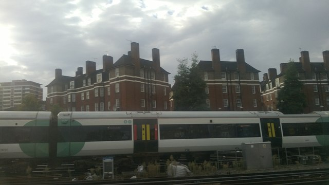 South of Victoria station: Peabody Estate flats seen over a Brighton train
