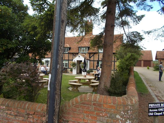 The Bell Inn through the trees