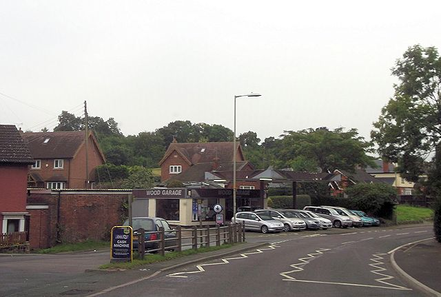 Wood garage at corner of Orchard Lane