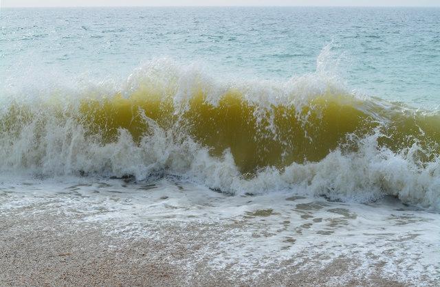 Breaking waves on Chesil Beach near East Bexington, Dorset
