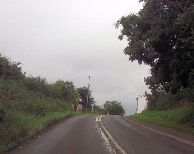 Approaching road junction near Malehurst Bank