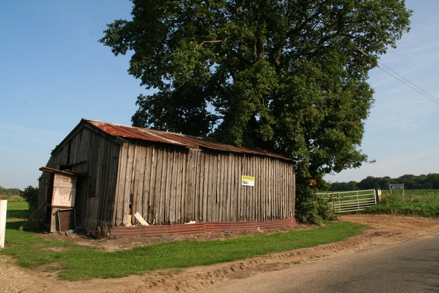 Tin roofed wooden shed next to the drive to Common Farm