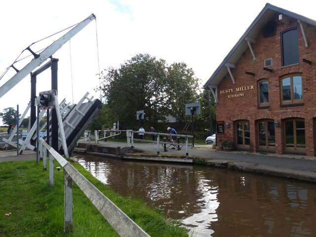 Lowering bridge over the Llangollen Canal after a barge has passed  through