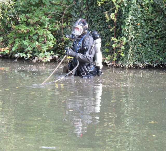 Police diver in the Grand Union Canal