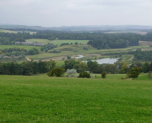 Looking down over pasture and trees