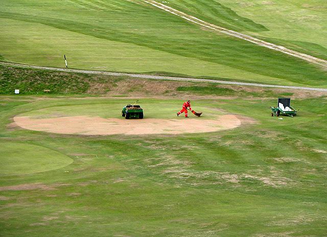Sanding a green at Cullen golf course