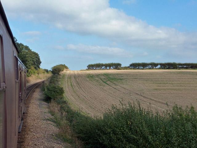 Stubble field by  North Norfolk Railway