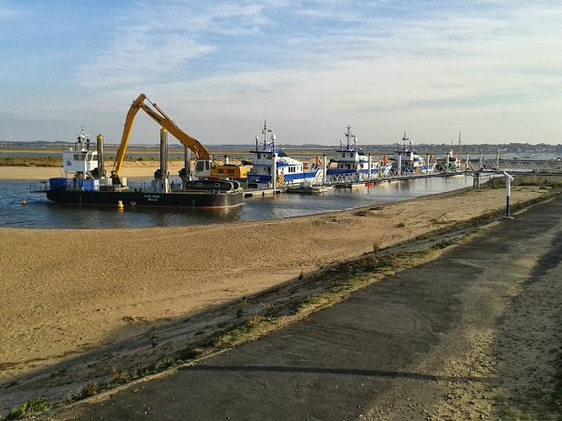 Dredger and support vessels for the off-shore wind farms at the lifeboat station