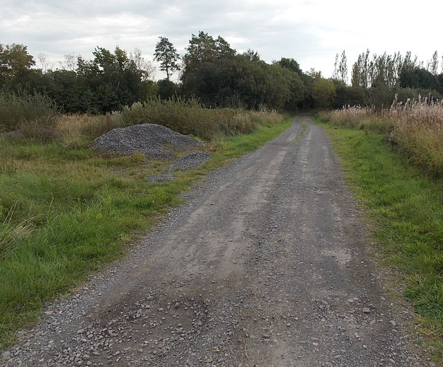 Pile of gravel alongside an access road near Grovesend
