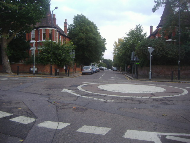 Mini roundabout at the junction of Exeter Road and Mapesbury Road