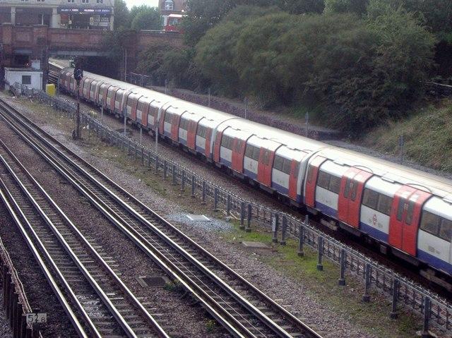 Underground train leaving Willesden Green Station