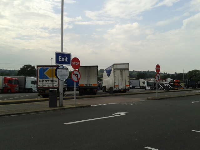 Lorry area of the parking at Toddington services, and the exit from the car parking area