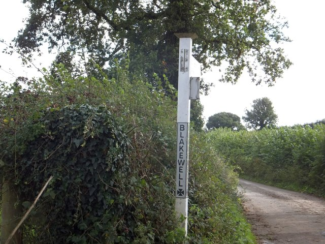 A damaged signpost at Blakewell Cross