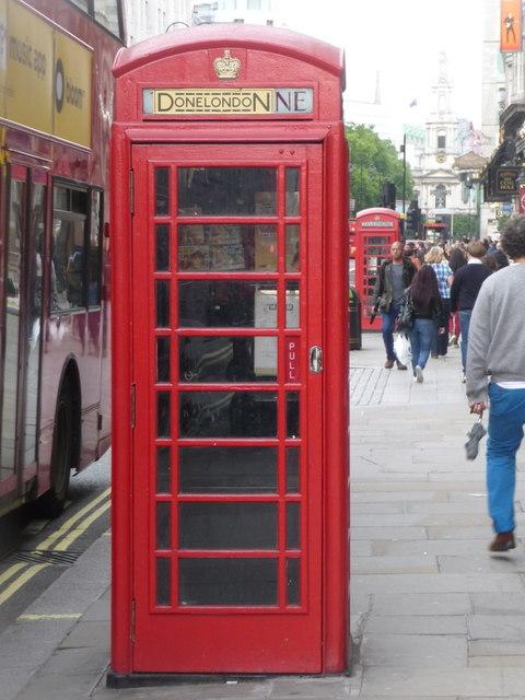 London: red phone box, 79 Strand