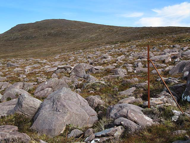 Rocky moorland and an old fence post in Torridon