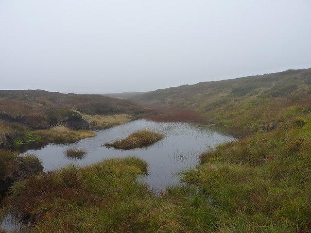 A small peaty pool above Coire nan Cisteachan