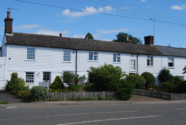 Row of weatherboarded Cottages