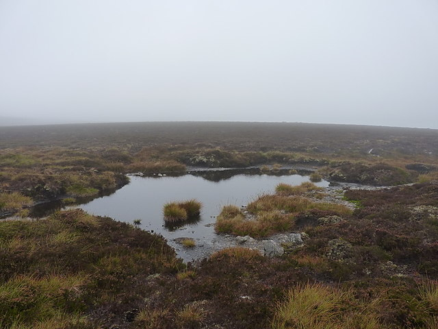 A boggy pool on the ridge NE of Beinn Bhreac