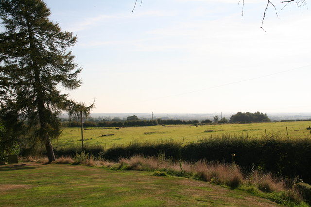 Field and a view from the churchyard, East Keal