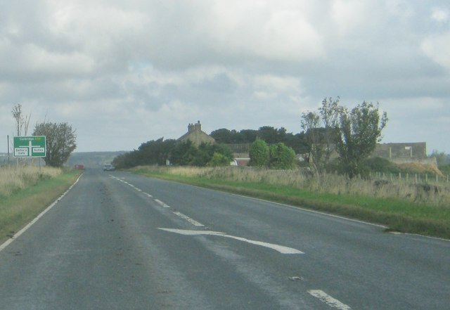 The A68 nearing crossroads, Drovers House Farm to the right