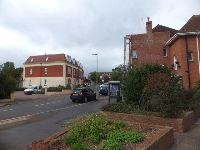 Cars parked outside shops in Littleham