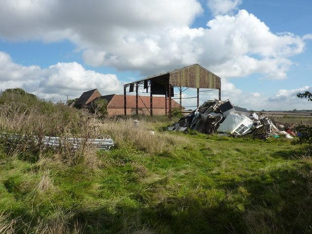 Rubbish dumped behind Holywell Farm