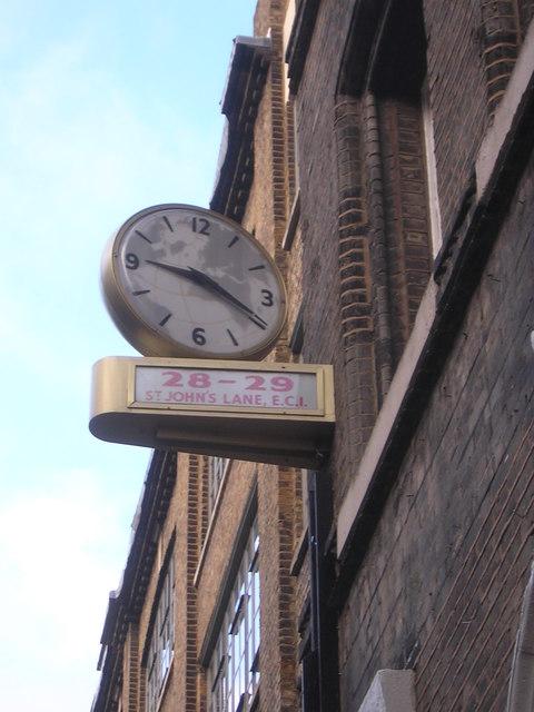 Clock on former travel firm's premises, St John's Lane, EC1