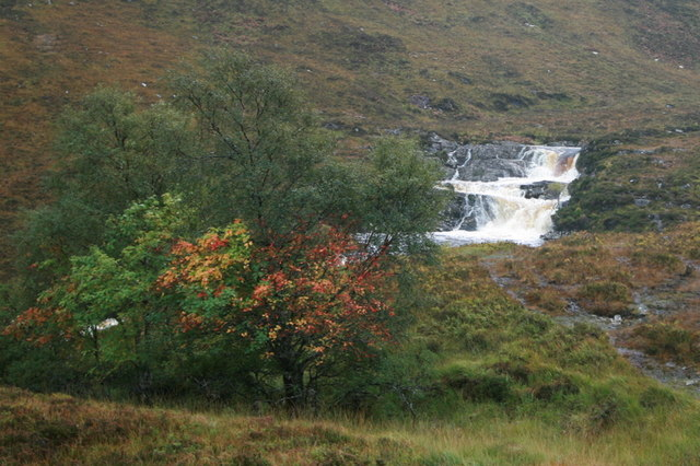 An angry waterfall on a chaotic autumn afternoon