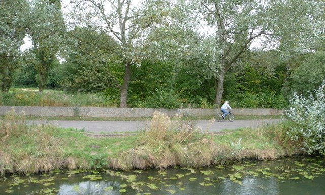 Cyclist on Route 64, north bank of Fossdyke