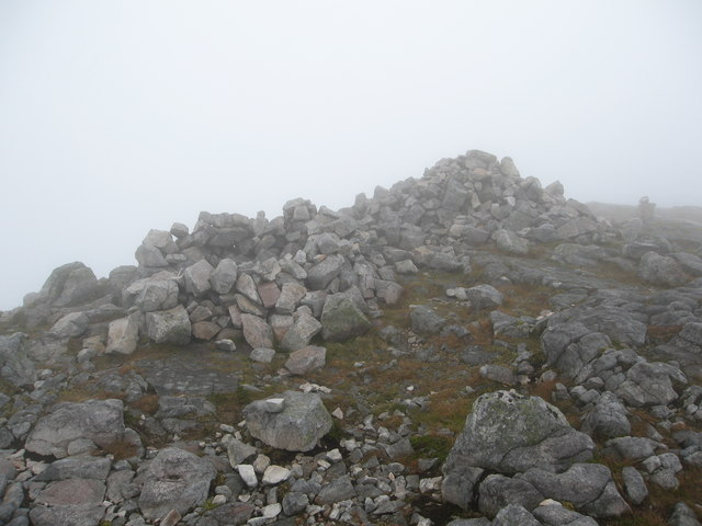 Summit cairn and a small shelter in cloud