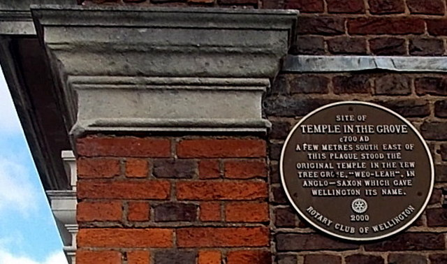 Brown plaque recording the origin of the town's name, Wellington, Shropshire