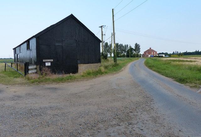 Black barn along Sandholme Lane