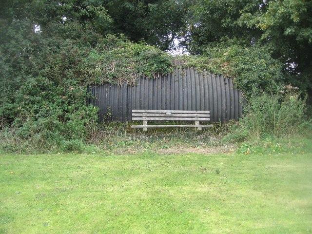Bench by a Nissen hut