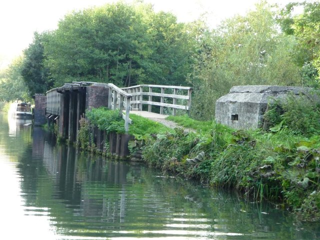 Pillbox and towpath bridge over weir