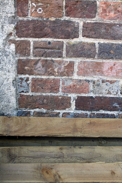 Benchmark on building at Loud's Mill