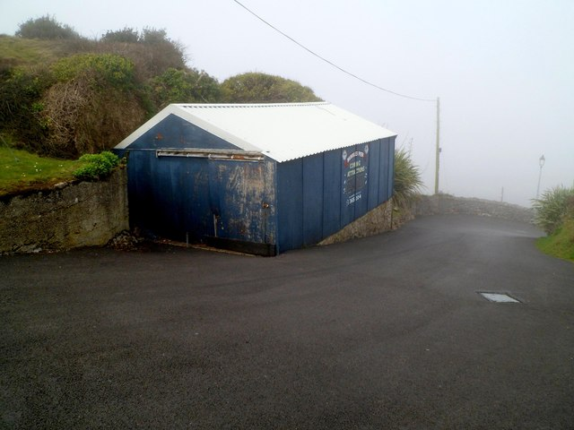 Metal building alongside the steep access road to Mumbles Pier, Swansea
