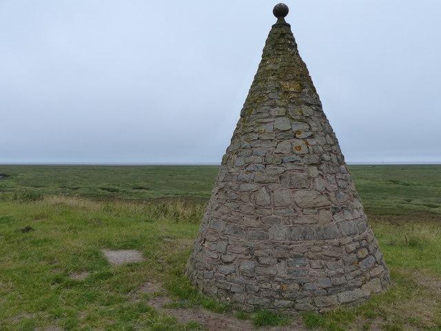 Monument overlooking The Wash salt marsh