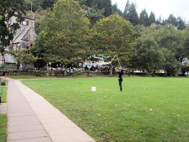 Bubble artist performing near St Michael's Church