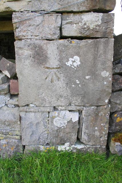 Benchmark on barn beside B6255 at Far Gearstones
