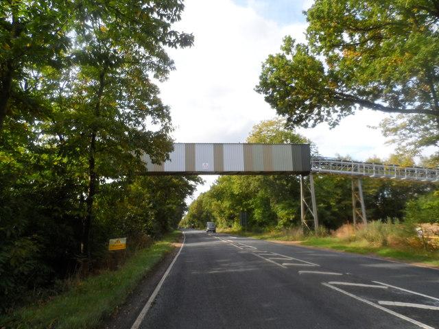 Conveyor belt for gravel workings crosses the A30 near Hartfordbridge