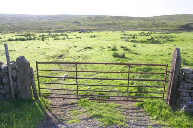 View through field gate on B6255 towards Little Round Hill