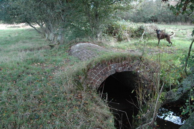 Brick bridge over drain on floodplain between heaths